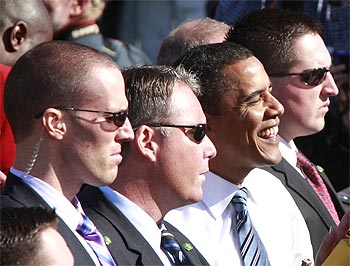US Secret Service agents escort Obama as he greets supporters