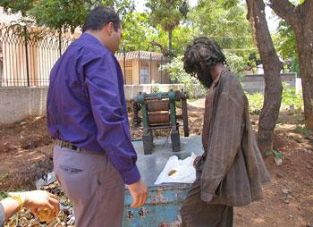Krishnan's wards often approach him when they see his food-laden van