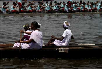 People watch the Nehru trophy race from their boat