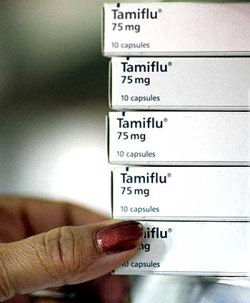 A pharmacist places boxes of Tamiflu on a shelf in Sydney