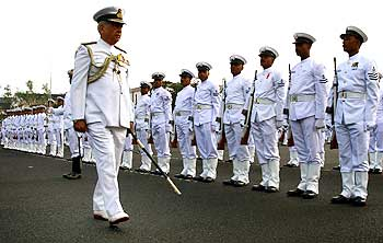 Admiral Sureesh Mehta reviews a ceremonial parade at the Southern Naval Command in Kochi.