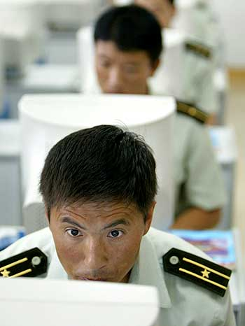 Chinese troops learn to use computers at a military base in Tianjin.
