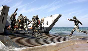 Soldiers with the navy's Landing Craft Mechanised vehicle during a war exercise.