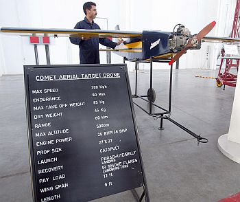 Pakistani air force technicians work on a unmanned spy Comet Aerial Target Drone aircraft