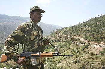A paramilitary soldier stands guard on the Jammu-Srinagar highway