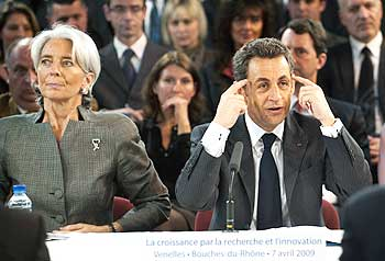 French Finance Minister Christine Lagarde and President Nicolas Sarkozy attend a meeting with industrial research leaders in Venelles