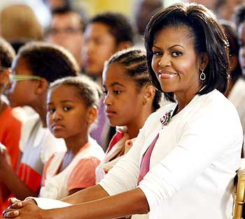 US First Lady Michelle Obama sits with daughters Sasha and Malia during the White House jazz studio event, part of the White House Music Series, in Washington