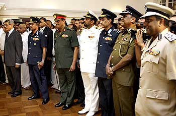 Gotabaya Rajapaksa, left with General Sarath Fonseka, 3rd left, Admiral Wasant Karannagoda, 4th left