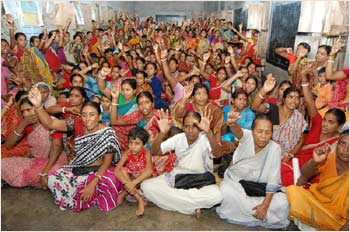 Women at Nishtha raise the slogan, Equality for All
