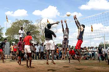Displaced Tamils play volleyball at the Kadiragarmarpura camp in northern Sri Lanka.