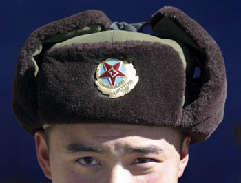 A Chinese soldier looks into the camera at the India-China trade route at Nathu-La, 55 north of Gangtok, capital of Sikkim