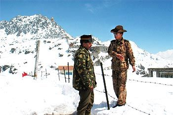 An Indian army officer talks with a Chinese soldier at the 4,310 metre high Nathu-la pass o