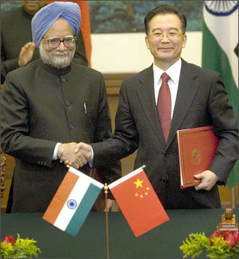 Prime Minister Manmohan Singh and Chinese Premier Wen Jiabao shake hands in Beijing