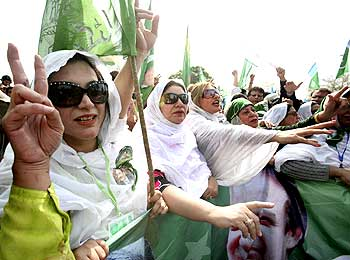 Pakistan Muslim League supporters celebrate Iftikhar Chaudhry's reinstatement as chief justice.