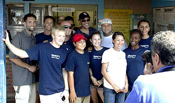 Obama (Centre, rear) poses with workers at Nancy's restaurant