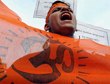 An activist from VHP, a Hindu hardline group, shouts slogans during an election awareness campaign