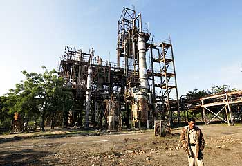 A security guard walks in front of the Union Carbide plant in Bhopal, which in December 1984 developed a toxic gas leak resulting in the death of thousands of people