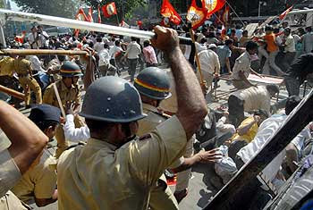 Police personnel cane demonstrators