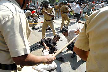 Police personnel cane violent protestors