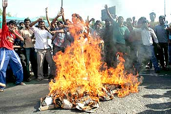 Students of Nizam college burning the effigy of the Chief Minister K Rosaiah