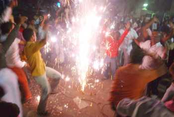 TRS supportrs burst crackers after the Centre gave the nod for a separate state