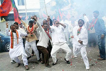 BJP workers celebrate outside the party office in Hyderabad