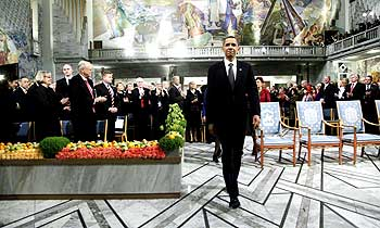 Barack Obama enters the Nobel Peace Prize ceremony at the City Hall in Oslo