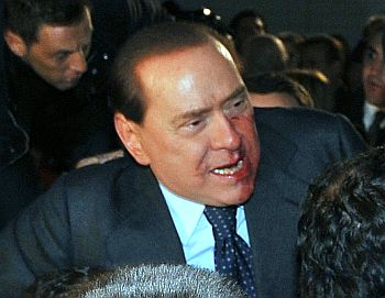 Blood covers part of the face of Italy's PM Berlusconi after he was attacked in Milan