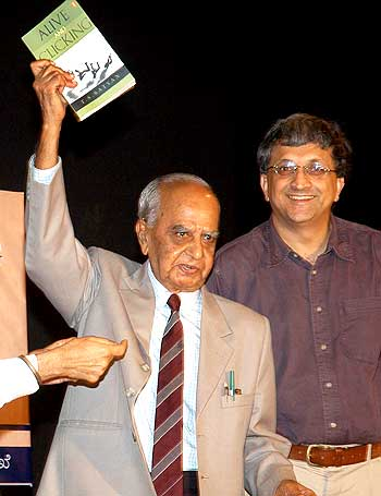 Veteran photojournalist T S Satyan during the launch of his book 'Alive and Clicking' with Ramachandra Guha