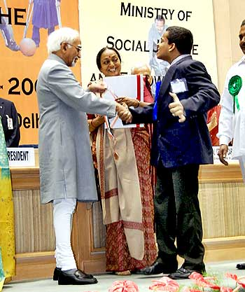 Siddharth winning the best employee award from the ministry of social justice and empowerment