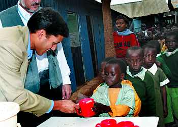 Shah at an aid distribution camp