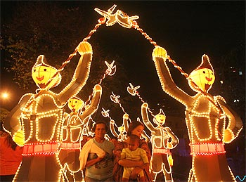 People view illuminated Christmas decorations in Cali, Columbia