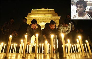 People light candles at a vigil to commemorate the victims of the 26/11 attack and (inset) Kasab