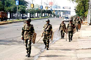 Security personnel patrol Hyderabad's streets