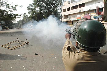 Police shoot tear gas shells to quell the mob