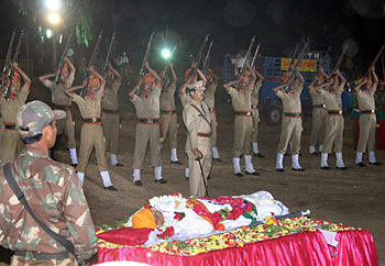 Police offer gun salute during the funeral ceremony