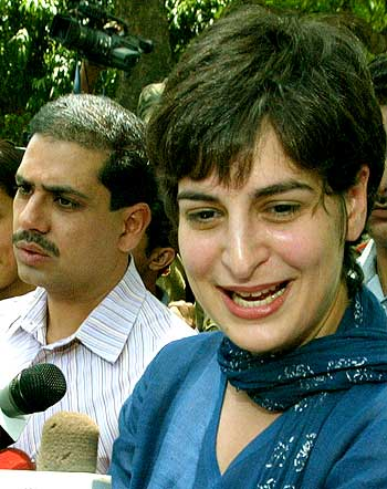 Robert Vadra (left) as Priyanka speaks to the media