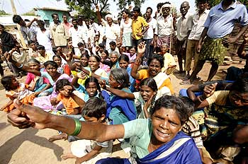 Flood-affected people protest against the lack of supplies at Bannur village near Hyderabad