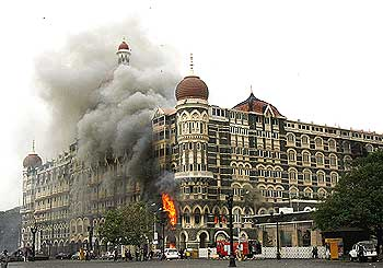The Taj Mahal hotel is engulfed in smoke during the 26/11 attacks in Mumbai