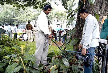 An officer surveying the blast site in Bengaluru in 2008
