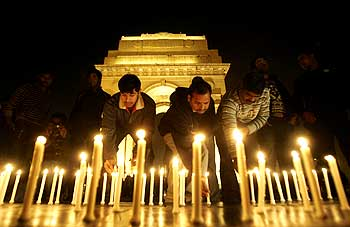 People light candles at a vigil to commemorate the Mumbai attacks in 2008