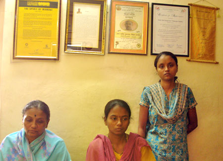 Omble's wife, Tarabai, left, with daughters Vandana and Vaishali.