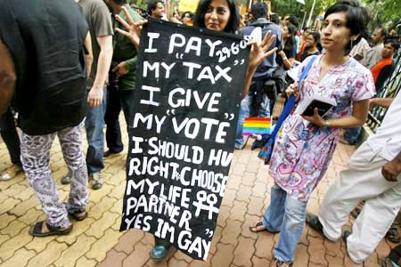 A woman holds a sign during a parade for gays and lesbian rights