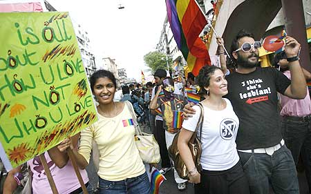 Participants hold placards during a parade for gays and lesbian rights in Mumbai