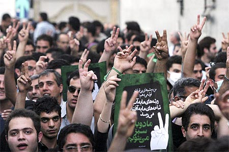 Iranian protesters show victory signs as they march near Ghoba mosque in northern Teheran June 2