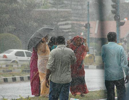 People enjoy a rare downpour in Bangalore