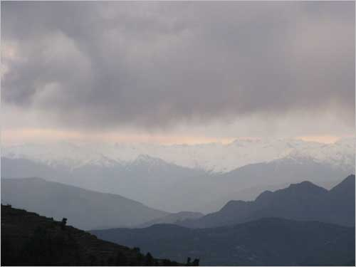 The majestic snowscaped mountains of Himalaya are kissed by the monsoon clouds.