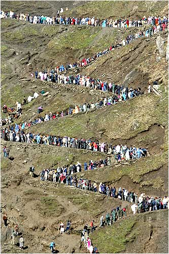 Devotees trek their way through the winding mountain