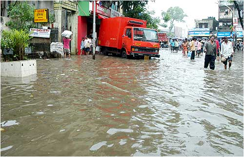 A transport vehicle that broke down in a flooded street