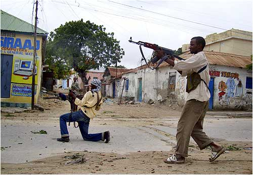 Fighters loyal to Hisbul Islam party take part in a street fight against Somali government forces.